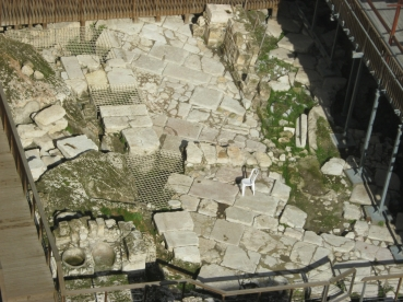 Traces of the Aelia Capitolina of Africanus' day peek up throughout modern Jerusalem. This street and accompanying shops of the Eastern Cardo were discovered next to the Western Wall plaza.