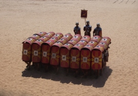Roman infantry locking shields in a testudo formation for protection against archers. Africanus argued this was a poor tactic which gave the enemy the initiative.