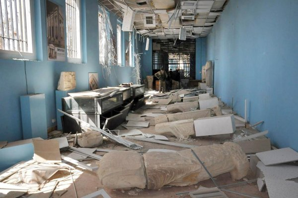 This photo released on Sunday March 27, 2016, by the Syrian official news agency SANA, shows destroyed statues at the damaged Palmyra Museum, in Palmyra city, central Syria. The amount of destruction found inside the archaeological area in the historic Syrian town of Palmyra was similar to what experts have expected but the shock came Monday, March 27, 2016 from inside the local museum where the extremists have caused wide damage demolishing invaluable statues that were torn to pieces. (SANA via AP)