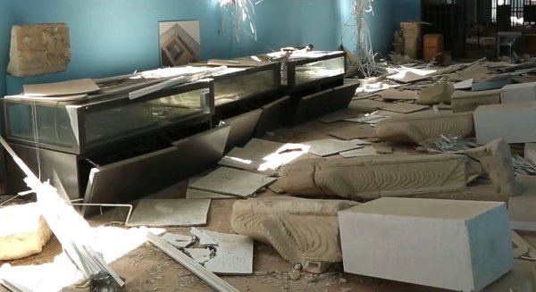 This photo released on Monday March 28, 2016, by the Syrian official news agency SANA, shows destroyed statues at the damaged Palmyra Museum, in Palmyra city, central Syria. A Syrian antiquities official says demining experts have so far removed 150 bombs planted by the Islamic State group inside the archaeological site in the historic town of Palmyra. Syrian troops captured the town from IS fighters on Sunday after three weeks of intense fighting. (SANA via AP)