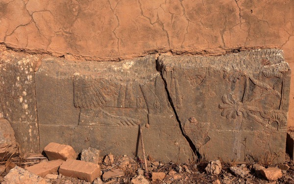 "Fragment of a ""tree of life"" relief. It is not clear if this damage is modern or ancient. (Safin Hamed/AFP)"